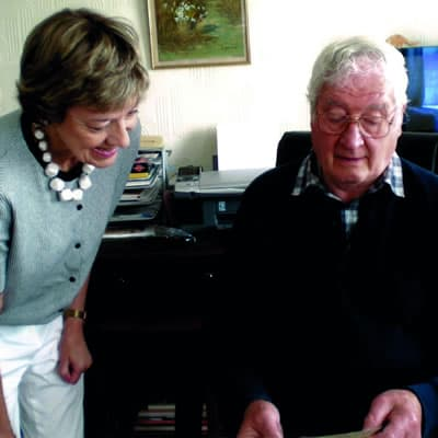 Photo of Bernard and Louise sorting their fathers' papers together