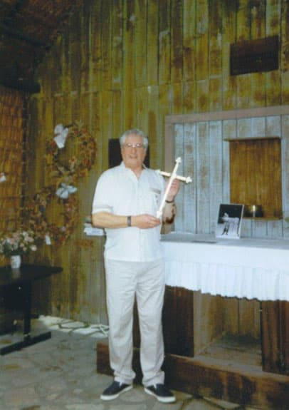 Bernard for the first time holding the cross his father made. Changi Museum Chapel, 1998.