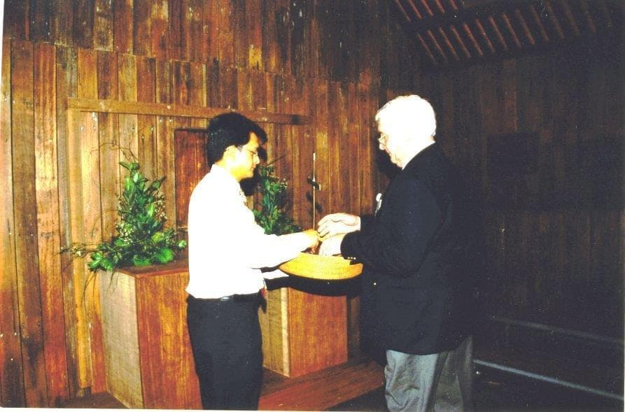 Bernard taking the cross to put on the altar of the new Chapel at Changi Museum February 15th 2001.